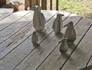 a set  of stainless metal peguins  made from scrap metal by Courtenay based artist and inventor John Czegledi