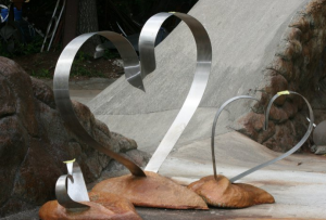 a trio of stainless metal heart sculptures by Courtenay based artist and designer John Czegledi