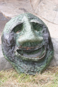 a whimsical concrete face made by John Czegledi from Comox Valley BC