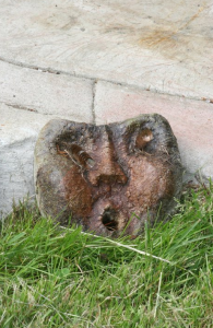 a whimsical concrete face sculpture by Courtenay based artist and cement finisher John Czegledi