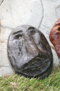 a whimsical concrete face created in cement by Courtenay BC based artist and craftsman John Czegledi