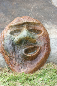 a whimsical concrete face crafted by artist and concrete finisher John Czegledi from Courtenay BC