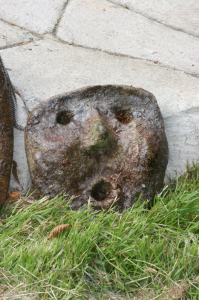 an artistic concrete facial sculture by artist and designer John Czegledi from Courtenay BC