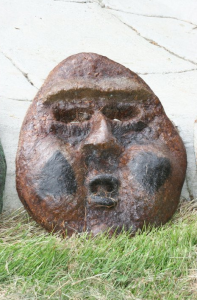 a funny concrete face sculpture by artist and designer John Czegledi from Courtenay BC