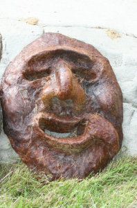 a whimsical concrete face by artist John Czegledi from Courtenay BC