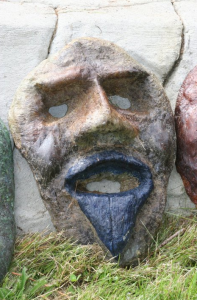 a whimsical concrete face by Courtenay based artist, invemtor and craftsman John Czegledi