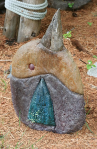 a concrete sculpture of a whimsical abstract bird by artist, inventor and concrete finisher John Czegledi