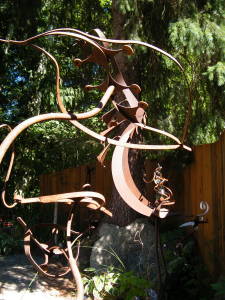 an abstract patina metal sculpture by Courtenay based artist and inventor John Czegledi