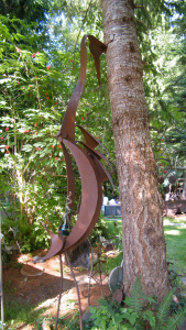 a patina metal heron abstract sculpture by John Czegledi an artist, inventor and master craftsman from Courtenay BC