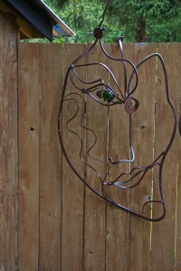 a patina scrap metal abstract face created by artist and inventor form Courtenal BC John Czegledi