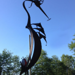a large patina metal heron by artist, inventor and craftsman John Czegledi from Courtenay BC