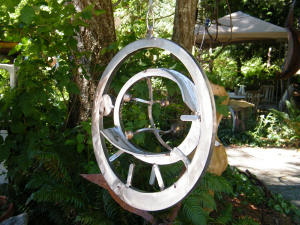stainless metal abstract circle art by Courtenat BC artist and designer John Czegledi