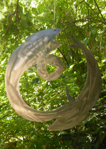 stainless metal abstract circle art by John Czegledi, an artis, inventor and master craftsman from Courtenay, BC