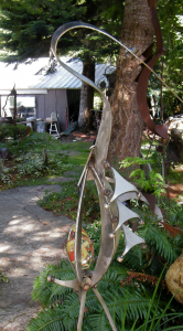 a stainless metal heron created by artist John Czegledi from scrap metal
