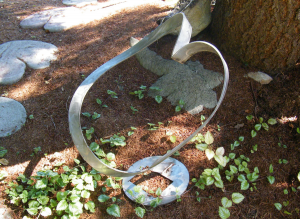 an abstract stainless metal heart sculpture by artist and inventor John Czegledi from Courtenay BC