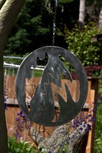 Stainless metal abstract hanging circle art by artist John Czegledi