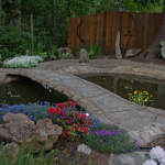 concrete patio, pond and driveway work by master craftsman and artist John Czegledi