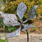 a large patina metal flower by artist and designer from Courtenay BC John Czegledi