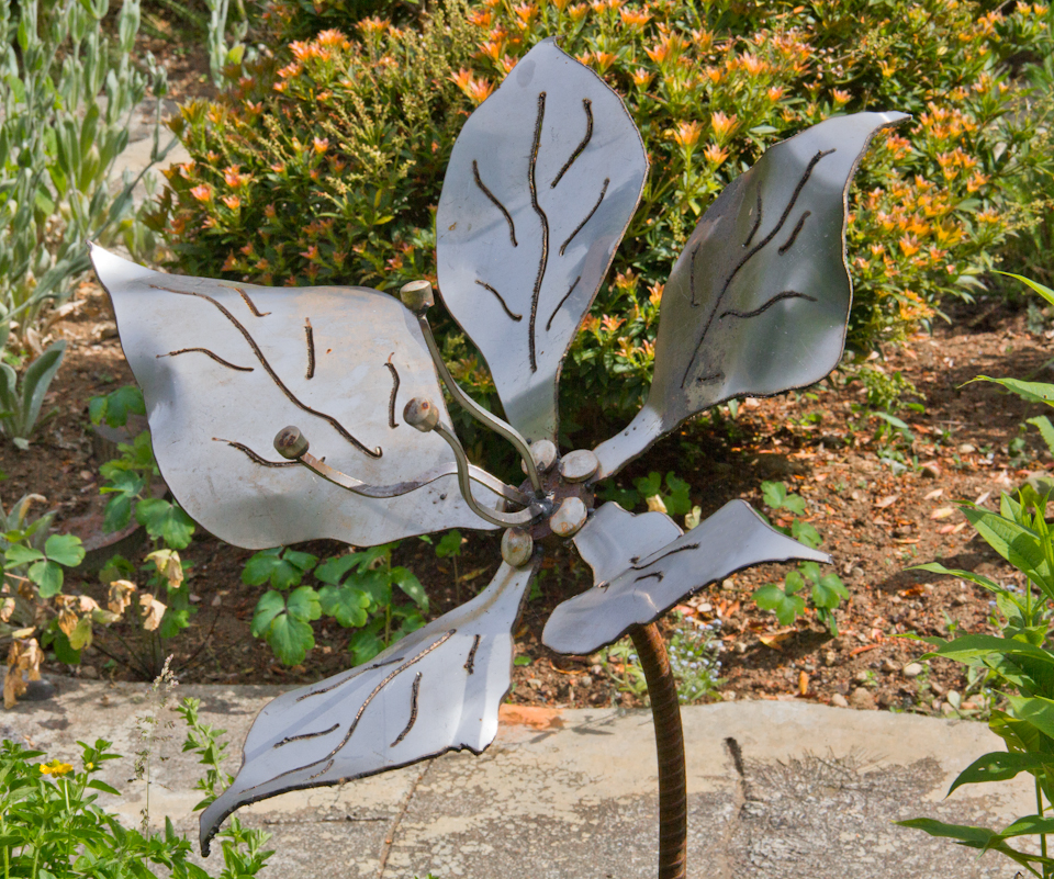 Patina metal flowers john czegledi inventions and for Metal garden designs